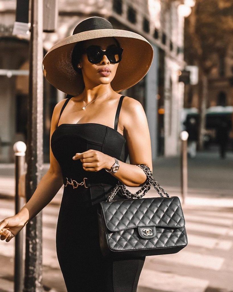 Classy black woman with Chanel designer handbag