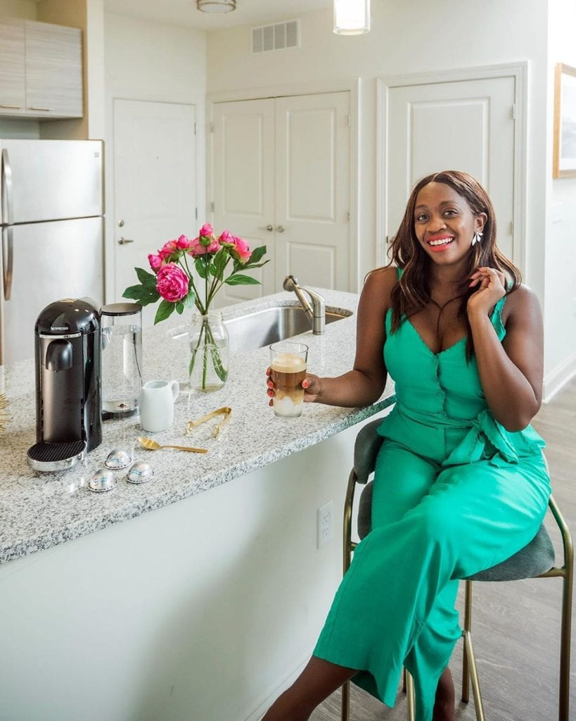 woman enjoying hotel style expresso at home
