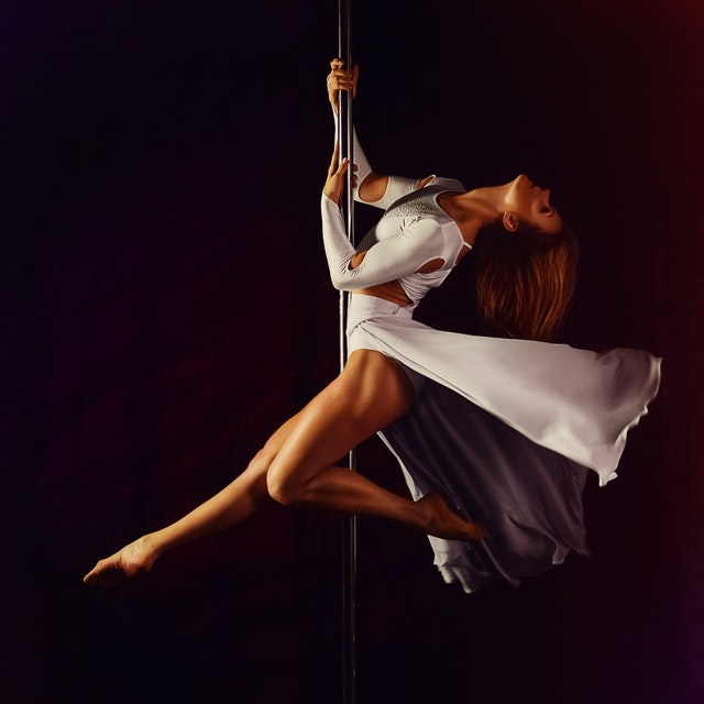 woman pole dancing hobby